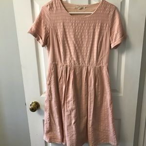 Pale orange/peachy colored dress. Size medium.